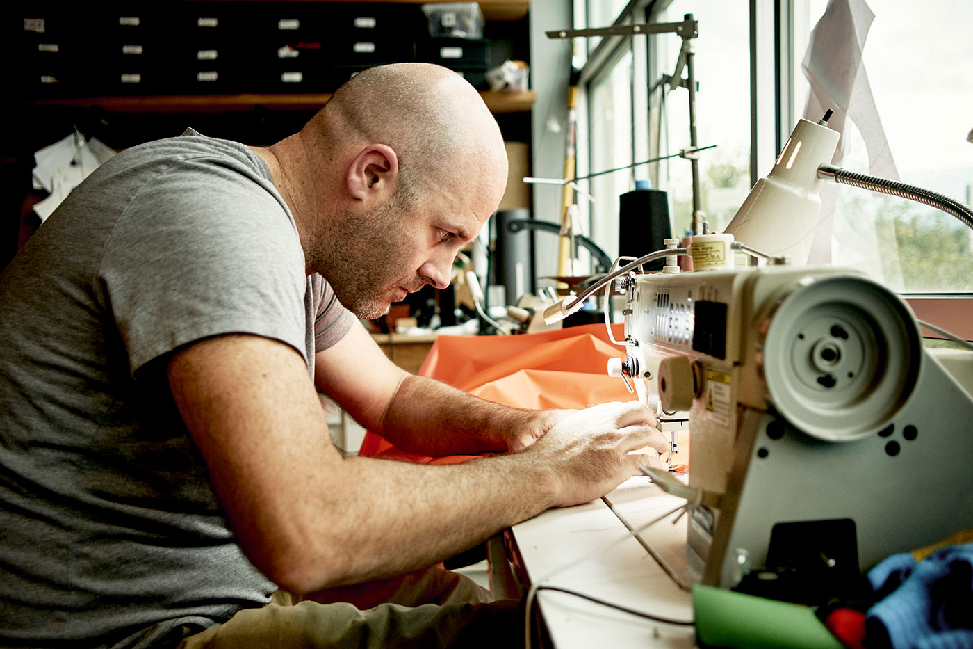 Ian Martin at the sewing machine